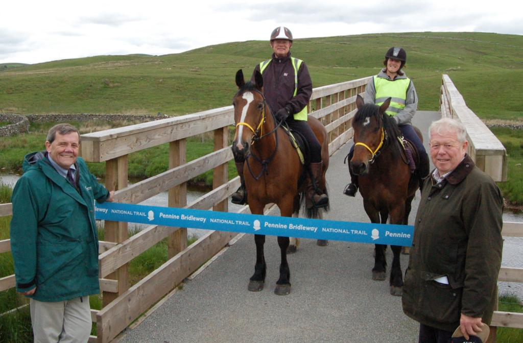 Martin Clunes centre with Alison Roper Stonetrail Riding Centre Carl Lis Chairman of YDNP and Poul Christensen Chairman of Natural England . - Pennine Bridleway goes all the way