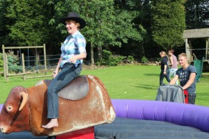 12 07 BBQ and Fun Day Judith on bucking bronco 300x200 - Ackworth Riding Club Round Up