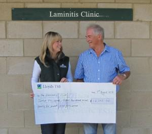 Rachel Austin of SPILLERS hands the cheque over to Robert Eustace