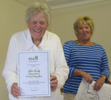 Somerset RDA Agnes gets her RDA award lo res - Two National Awards for Somerset Carriage-Driving for the Disabled