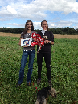 Tess Wheldon (rider) and her mother, Paula Bocalandro, collecting the prizes on behalf of the team.JPG