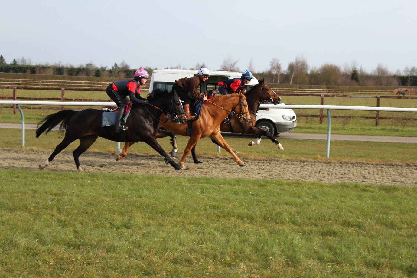 Andrea Atzeni flanked by Charlotte Butler nearside and Paddy Bradley - Residential Pony Camp Races to Success