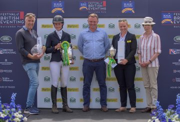 Lucy Wheeler receiving her prizes as winner of the TopSpec Challenge for The Corinthian Cup. 360x245 - Lucy and King Creole Head the TopSpec Challenge for The Corinthian Cup