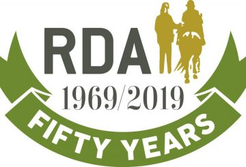 RDA 50th Brand gold 360x245 - HRH Princess Anne Launches 50th Anniversary Tartan for Riding for the Disabled Association in Scotland