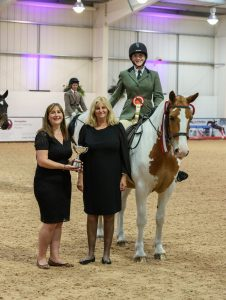 Eleanor Currington receives her prize from Nicky Mackenzie from SEIB and Sarah Hadley from the RDA Credit Nico Morgan 226x300 - The SEIB Search for a Star Riding for the Disabled Championship