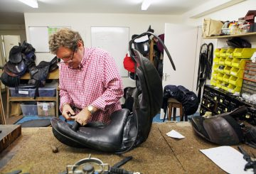 Maurice at the work bench 360x245 - Maurice Emtage – A Life in Saddlery