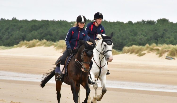Georgie and Edward ride into Holkham beach CREDIT Veale Family 750x440 - Over £13,000 raised for St Elizabeth Hospice after 200-mile coastal horse ride in memory of much-loved father
