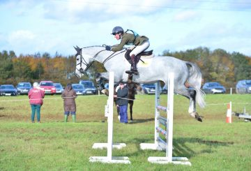 Eliza Stoddart and De Pleasure in the show jumping 360x245 - Eliza Stoddart Defends Five-Year-Old Championship at Oasby